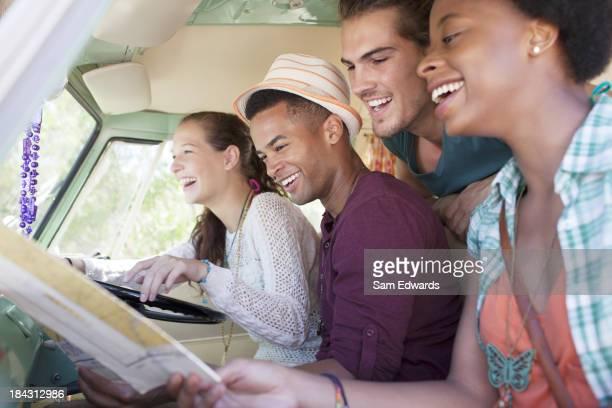 Smiling friends in van