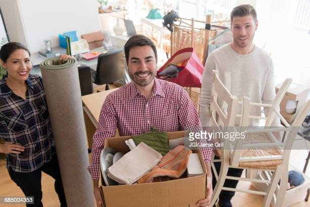 Smiling friends moving house
