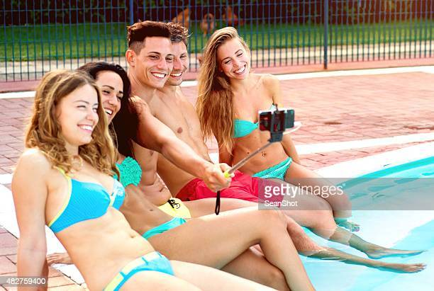 Smiling Friends near a Swimming Pool Doing Selfie