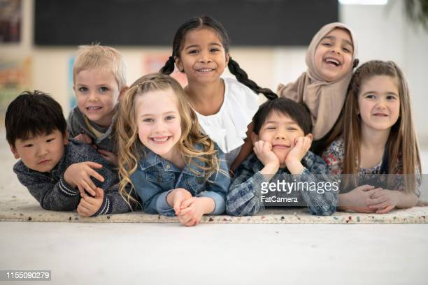 smiling friends - montessori education stock pictures, royalty-free photos & images