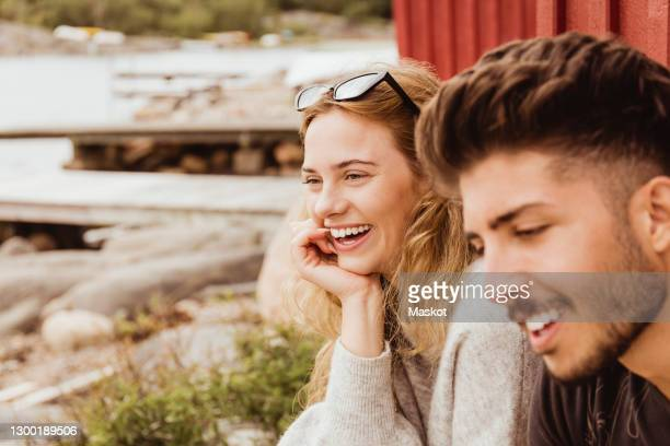 smiling friends spending leisure time at harbor - sweden stock pictures, royalty-free photos & images