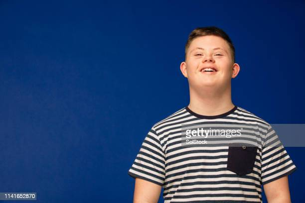 smiling from ear to ear - down syndrome stock pictures, royalty-free photos & images