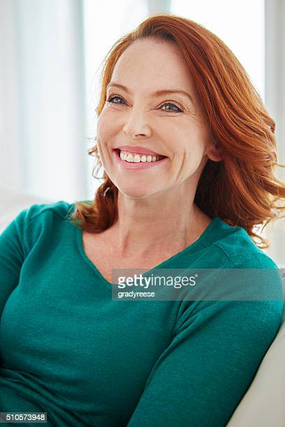 smiling from ear to ear - older redhead stock pictures, royalty-free photos & images
