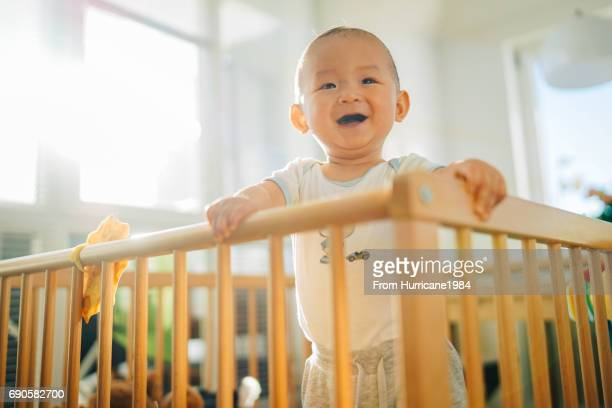 Smiling from playpen
