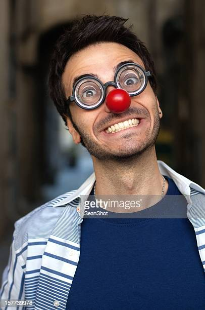 smiling funny man with strange nose and glasses. - happy clown faces stock photos and pictures
