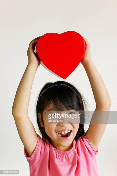 Smiling girl and heart box
