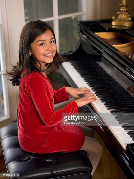 Smiling Girl at Piano