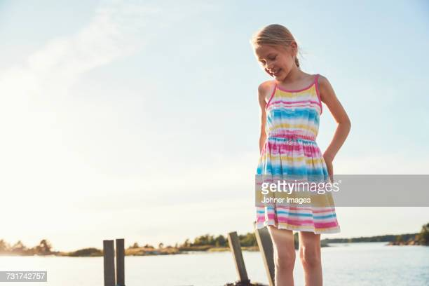 Smiling girl by lake