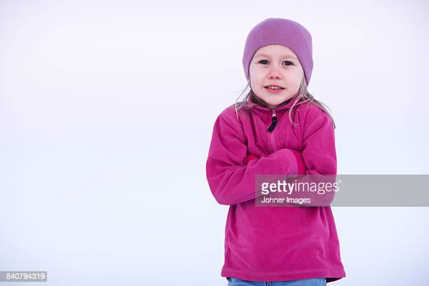 Smiling girl feeling cold