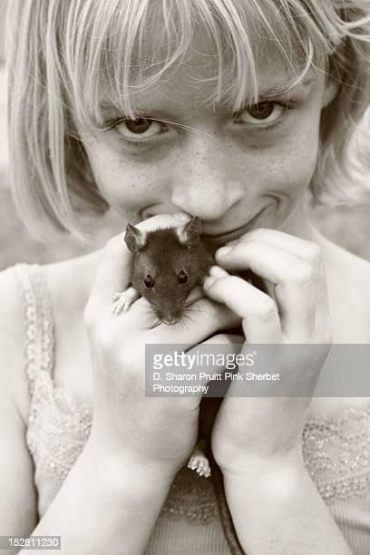 Smiling girl holding pet rat