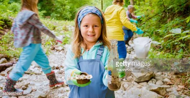 portrait smiling girl holding dirty medicine