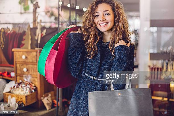 Smiling girl holding shopping bags