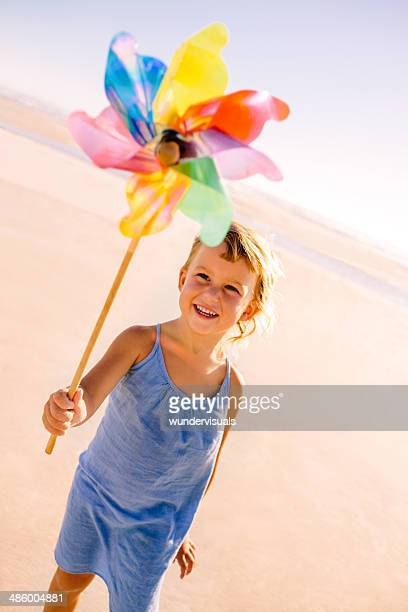 Smiling girl holding windmill