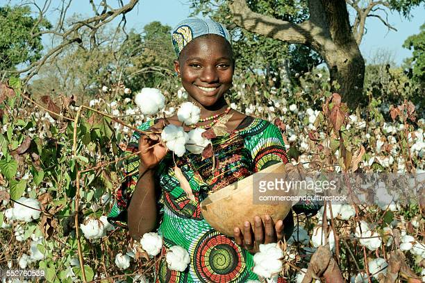 A smiling girl in a cotton field