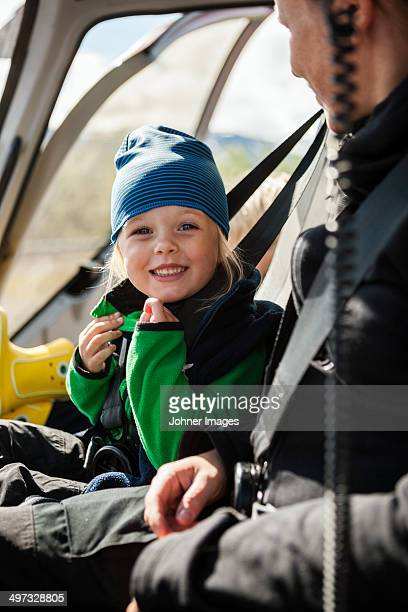 smiling girl in vehicle, kebnekaise, lapland, sweden - inside helicopter stock pictures, royalty-free photos & images
