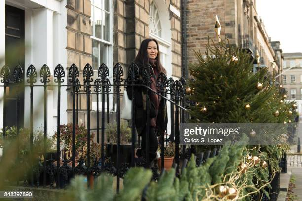 smiling girl leaving house for shopping - outdoor christmas - magic doors stock pictures, royalty-free photos & images