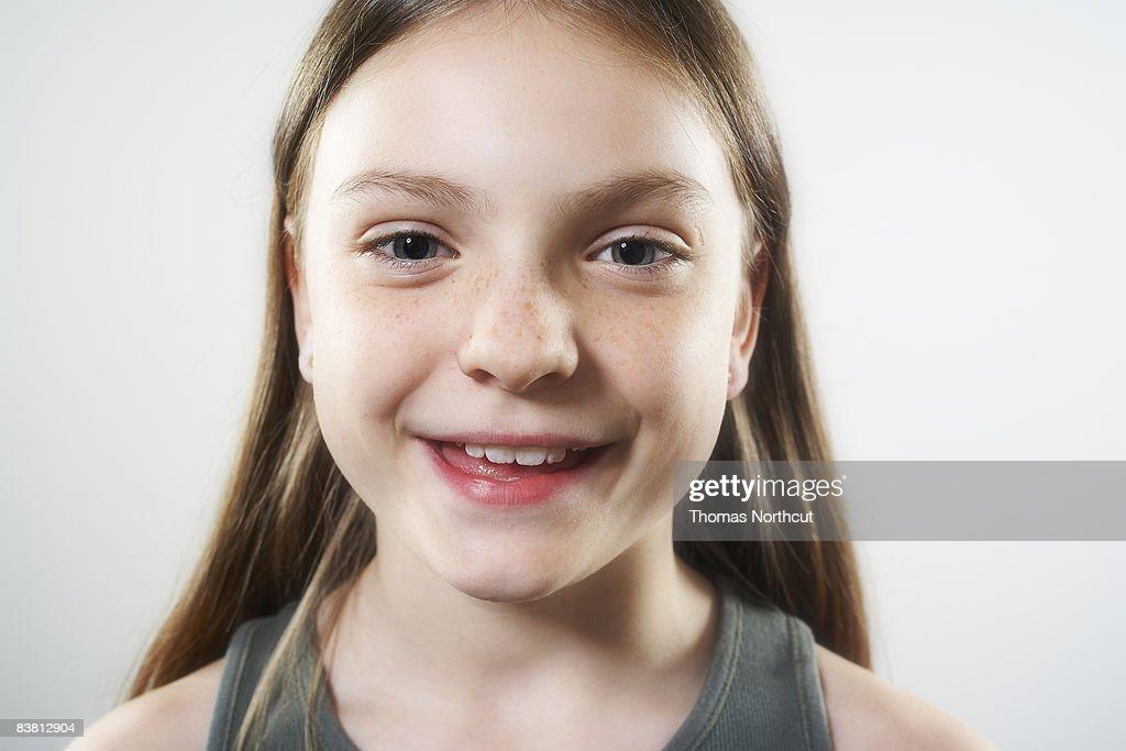 Smiling girl looking at camera : Stock Photo