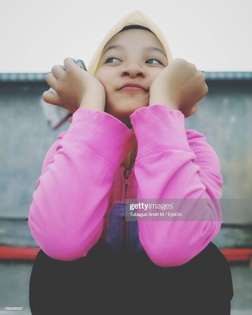 Smiling Girl Looking Away While Wearing Hijab : Stock Photo