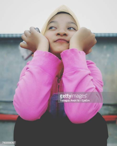 Smiling Girl Looking Away While Wearing Hijab