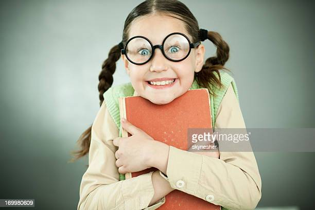 smiling girl nerd holding her book. - girl nerd hairstyles stock photos and pictures