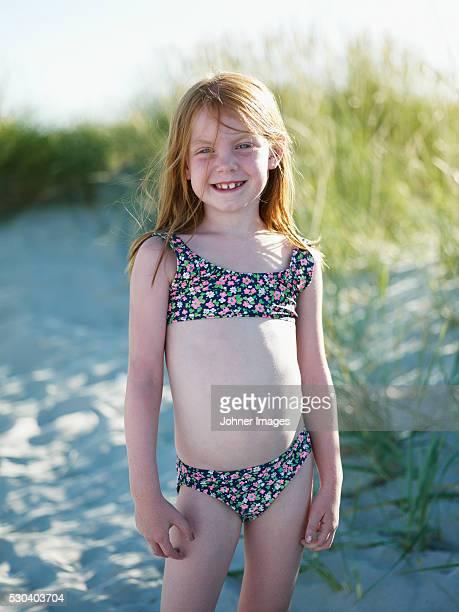 Smiling girl on beach