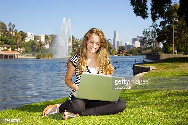 Smiling Girl on Laptop in Park Outdoors in Los Angeles