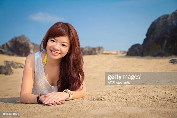 smiling girl on the sand - malaysia beautiful girl stock photos and pictures