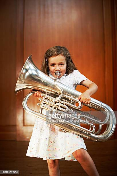Smiling girl playing tuba