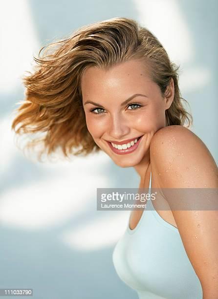 Smiling girl posing in wind