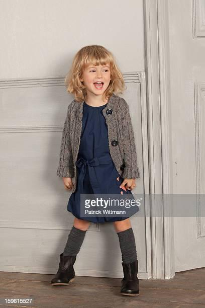 smiling girl shouting indoors - ein mädchen allein stock-fotos und bilder
