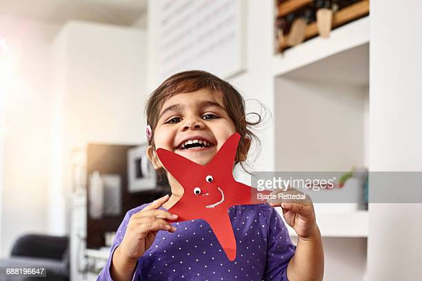 smiling girl showing her self-made starfish - art and craft stock pictures, royalty-free photos & images