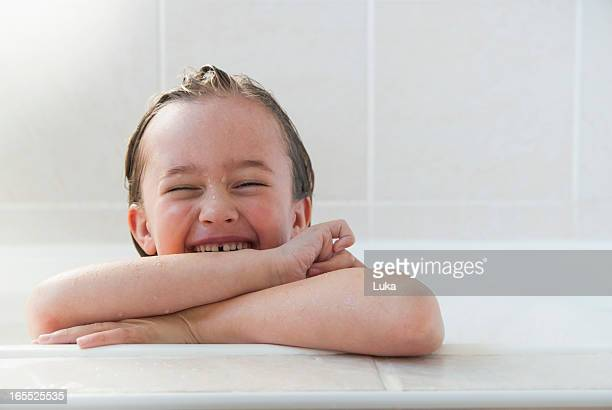 Smiling girl sitting in bath