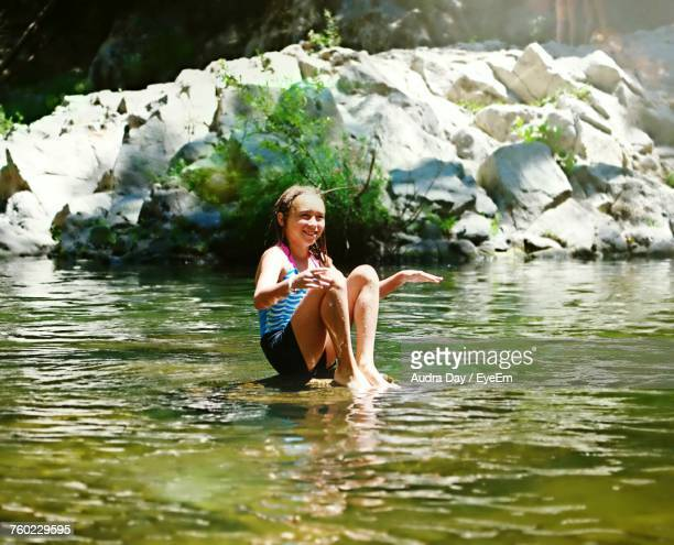smiling girl sitting in lake at big basin redwoods state park - big basin redwoods state park stock pictures, royalty-free photos & images