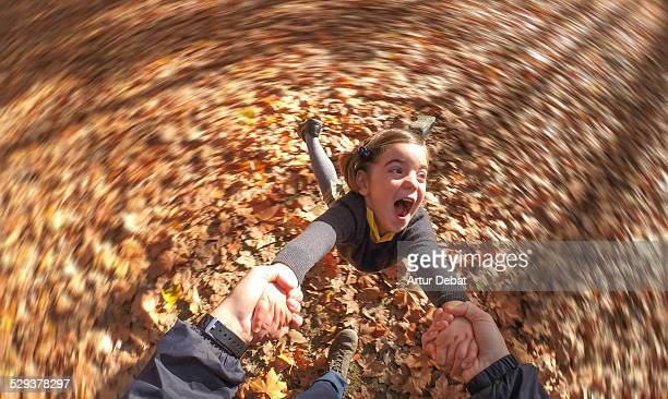 smiling girl spinning and holding dad's hands - point of view stock pictures, royalty-free photos & images