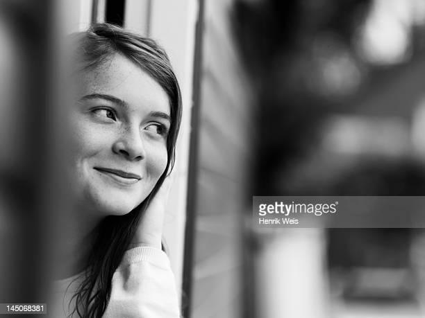 Smiling girl standing in doorway
