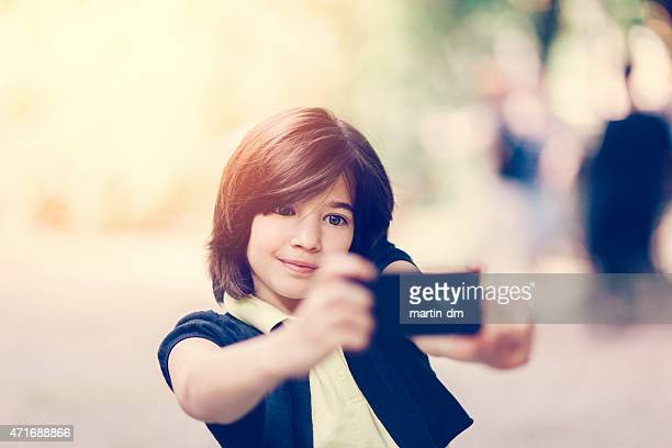 Smiling girl taking a selfie