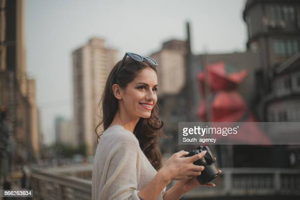 smiling girl taking photos - blouse stock pictures, royalty-free photos & images