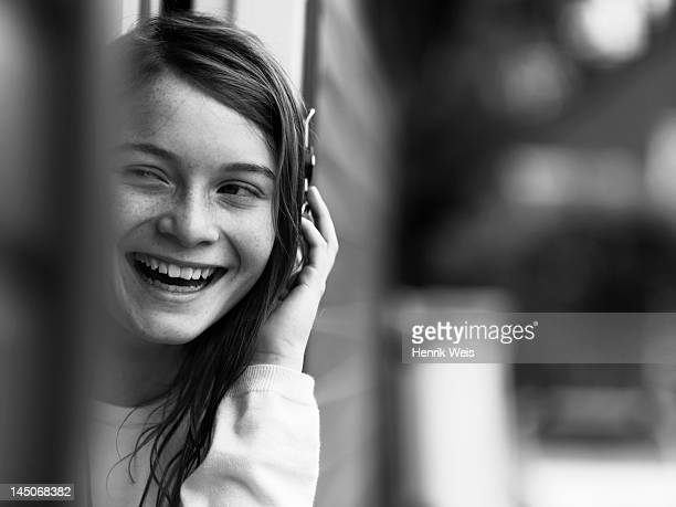 Smiling girl talking on cell phone
