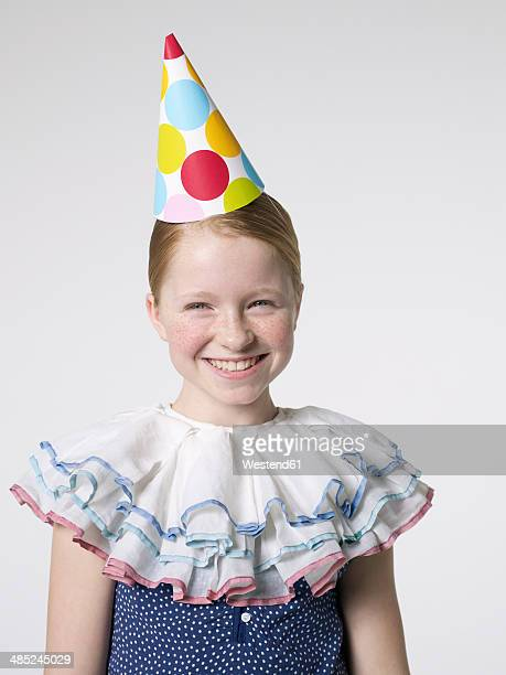 Smiling girl wearing party hat