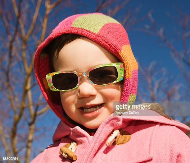 Smiling girl wearing sunglasses