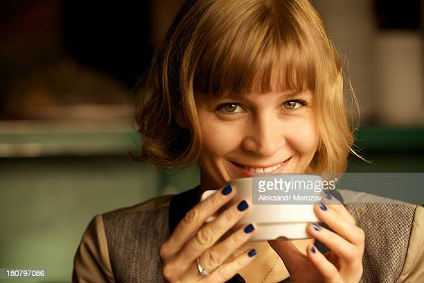 smiling girl with a coffee - hazel eyes stock pictures, royalty-free photos & images