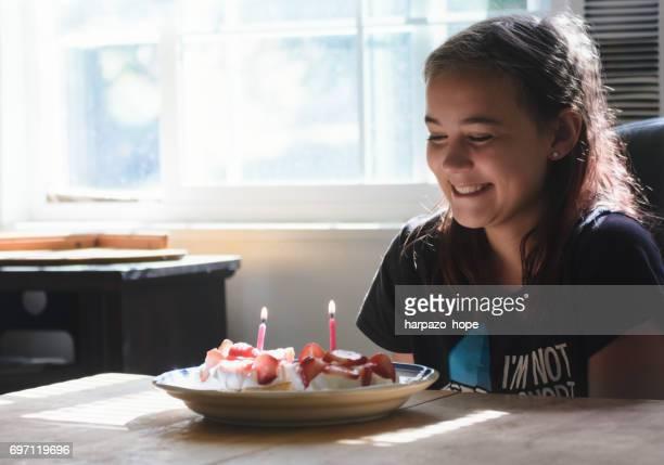 smiling girl with birthday waffles - candle of hope imagens e fotografias de stock