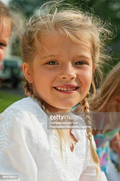 smiling girl with braids in her hair