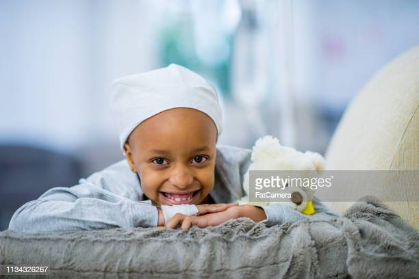 smiling girl with cancer - cute nurses stock pictures, royalty-free photos & images