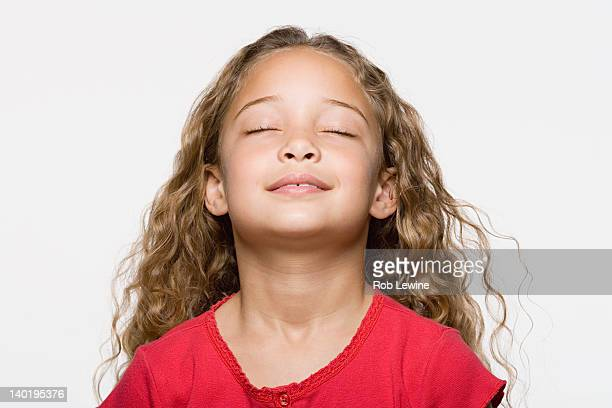 smiling girl (8-9) with eyes closed, studio shot - eyes closed stock pictures, royalty-free photos & images