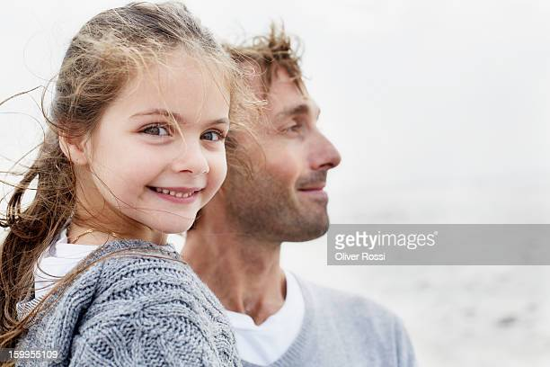 Smiling girl with father outdoors