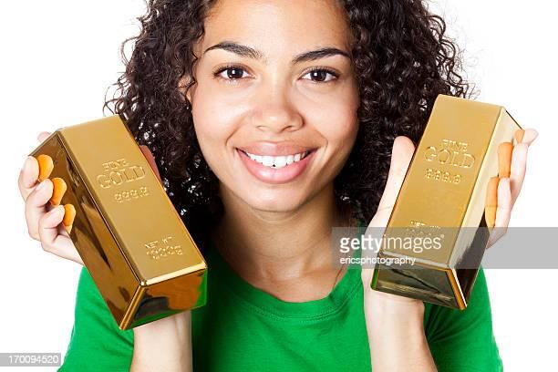 Lächelnd Mädchen mit gold bars
