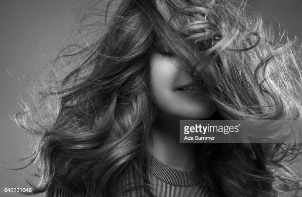smiling Girl with hair blowing, studio shot