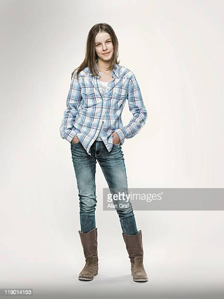Smiling girl with hands in pockets