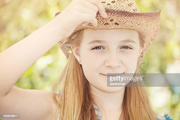 Smiling Girl With Long Blonde Hair Wearing Straw Hat